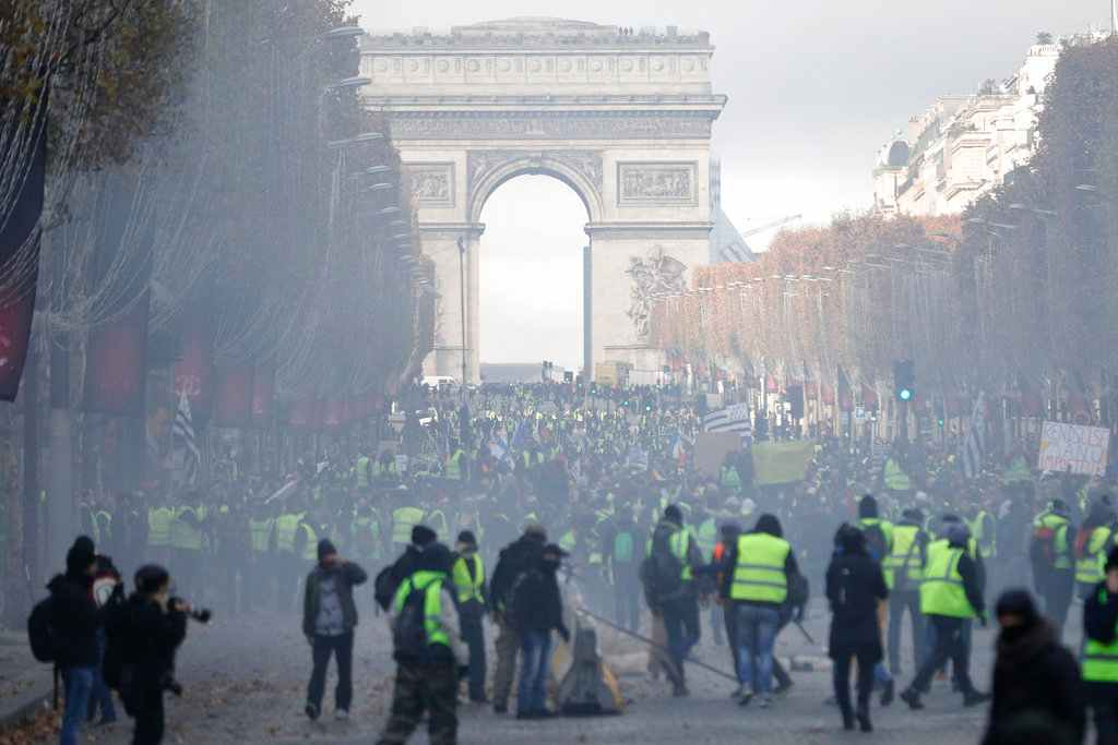 French police use tear gas, water cannon against Paris protesters